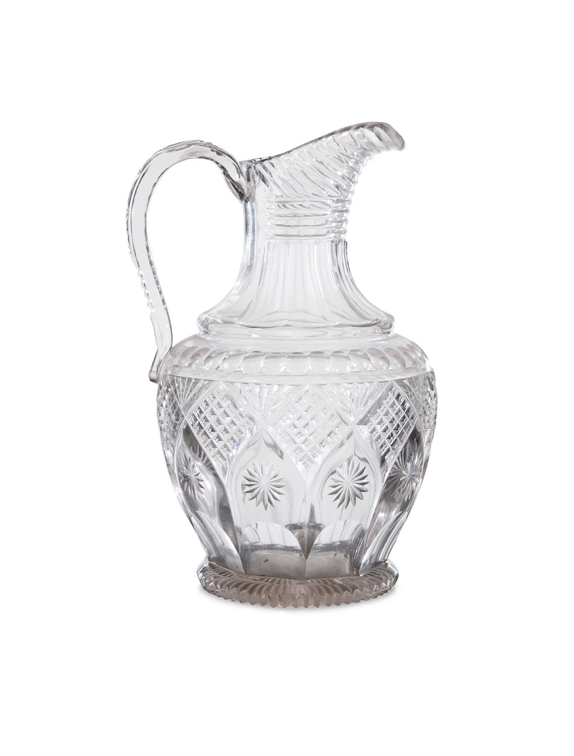 AN IRISH REGENCY CUT GLASS WATER PITCHER WITH STEP-CUT NECK, faceted shoulders, with diamond and