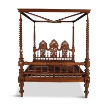 A VICTORIAN MAHOGANY FOUR POSTER BED, in 17th century style, having a cavetto cornice supported by