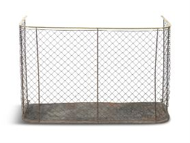 A VICTORIAN BRASS AND WIRE PANEL NURSERY FENDER, of bowed shaped design with trellis mesh panel and