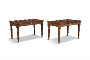 A PAIR OF OAK LUGGAGE STANDS, C.1900, retailed by Miller's & Beattie, Dublin, each with six lateral