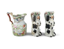 A PAIR OF 19TH CENTURY STAFFORDSHIRE JUGS, moulded in the form of spaniels. 26cm high; Together