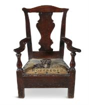 A SMALL PROVINICAL CHILD'S CHAIR, late 18th century with solid vase shape splat, drop in seat and