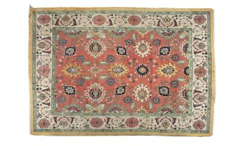 ***ADDITIONAL LOT*** A LARGE CAUCASIAN WOOL CARPET, the rectangular central field woven with