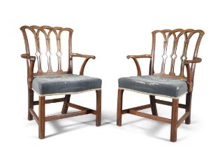 A PAIR OF GEORGE III PALE MAHOGANY FRAMED ARMCHAIRS IN THE GOTHIC TASTE, the pierced back having