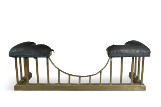 A LATE VICTORIAN BRASS AND LEATHER UPHOLSTERED CLUB FENDER, with angled corner seats and dipped