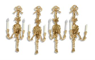 A SET OF FOUR GEORGIAN STYLE GILTWOOD TWO-LIGHT WALL SCONCES, surmounted with tied ribbons bedecked