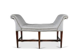 AN IRISH SERPENTINE MAHOGANY FRAMED WINDOW SEAT, C.1780, with upholstered out-scrolled arms,