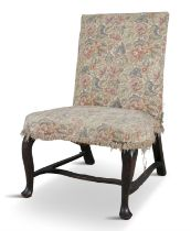 AN UNUSUAL WALNUT FRAMED IRISH PARLOUR CHAIR, c.1740, with raked back, the upholstered seat with