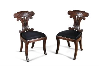 A PAIR OF MAHOGANY REGENCY NEO-GRECIAN HALL CHAIRS, with bowed tablet cresting, and conjoined