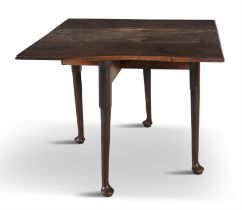 AN IRISH DROP-LEAF MAHOGANY TABLE, MID-18TH CENTURY, on tapering gate-leg supports with pad feet.