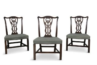 A SET OF THREE GEORGE III MAHOGANY DINING CHAIRS, each rectangular back with pierced interlaced