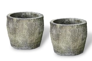 A PAIR OF 19TH CENTURY IRISH CARVED LIMESTONE CIRCULAR TROUGHS, with engraved variegated tapering