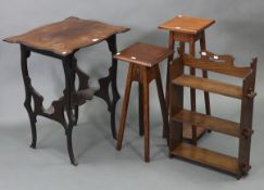 """A set of oak wall shelves of three open tiers, 17¼"""" wide x 26½"""" high x 5½"""" deep; together with an"""