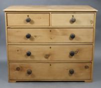 """A pine chest, fitted two short & three long graduated drawers with turned knob handles, 41¾"""" wide"""