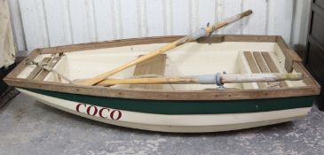 """A fibreglass & wooden rowing boat """"Coco"""" , 71"""" long, complete with a pair of oars."""