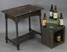 """A 1930's oak rectangular two-tier occasional table on barley-twist legs & turned feet, 30"""" wide x"""