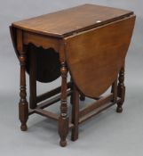 """An oak oval gate-leg dining table on baluster-turned legs & turned feet with plain stretchers, 33"""" x"""