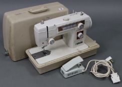 A New Home electric sewing machine with case, w.o.