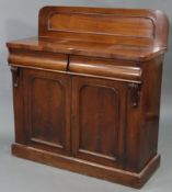 A Victorian mahogany small chiffonier with low-stage panel back, fitted two frieze drawers above