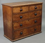 A 19th century oak chest fitted two short & three long graduated drawers with ebonised turned knob