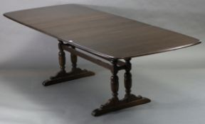 An Ercol extending dining table with rectangular top, three additional leaves, pull-out action, &