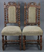 A similar pair of hall chairs.