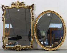 """A gilt frame oval wall mirror with egg & dart border & inset bevelled plate, 22½"""" x 18"""", & a gilt"""