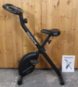 """A Gold's gym """"Venice"""" exercise bike."""