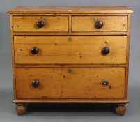 A late Victorian pine chest, fitted two short & two long graduated drawers with turned knob handles,