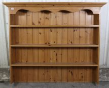 """A pine dresser top fitted three open shelves & with panelled back, 58"""" wide x 40½"""" high x 7½"""" deep."""