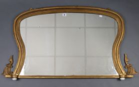"An early 20th century giltwood frame rectangular overmantel mirror on ceramic bun feet, 43½"" wide"