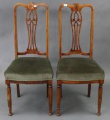 A pair of late 19th/early 20th century inlaid-mahogany splat-back occasional chairs with padded
