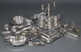 A quantity of silver plated items including a large engraved circular tray with pierced Greek-Key