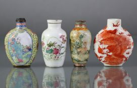 A Chinese porcelain snuff bottle of rounded form, with iron-red decoration of a dragon chasing the