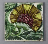 """A William De Morgan 6"""" BBB pottery tile with stylised floral decoration, impressed Merton Abbey"""