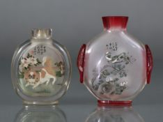 Two Chinese inside-painted snuff bottles, the smaller of clear glass & decorated with Shih Tzu &