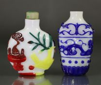 A Chinese overlay glass large snuff bottle of rounded form, with carved decoration through the