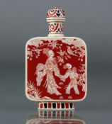 A Chinese stained ivory snuff bottle of flat-sided rectangular form, each side decorated with