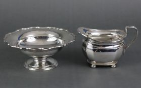 A silver circular sweetmeat dish, with shaped rim on a round pedestal foot, Birmingham 1932 by
