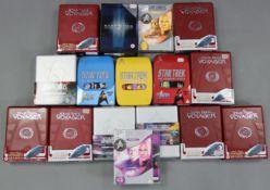 "Three ""Star Trek Original Series"" DVD box sets (series 1-3); seven ""Star Trek Voyager"" DVD box"