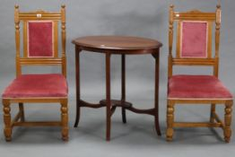 A pair of late Victorian bedroom chairs with padded backs & sprung seats upholstered pink