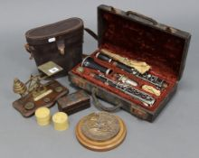 """A Console rosewood clarinet with chrome fittings (No. 2314), 26¼"""" long, cased; together with a brass"""