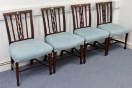 A set of four early 20th century mahogany splat-back dining chairs with padded seats, & on square