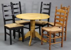 A maple-finish circular drop-leaf pedestal kitchen table on turned centre column & four cabriole