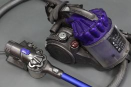 """A Dyson cylinder vacuum cleaner; & a ditto """"DC44 Animal"""" cordless vacuum cleaner, both w.o."""