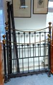 A Victorian-style black-finish tubular metal 4' bedstead, complete with side rails.