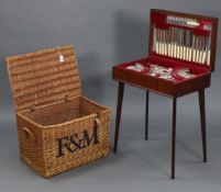 """A Fortnum & Mason wicker hamper (lacking contents) 22"""" wide x 15"""" high; together with a canteen of"""