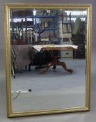 "A large gilt frame rectangular wall mirror inset bevelled plate, 50"" x 39""."