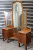 A mid-20th century oak dressing chest in the continental style, with triple panel mirror to the