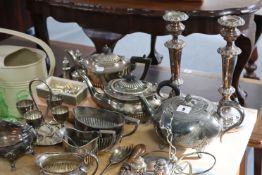 A silver plated oval entrée dish; a pair of silver plated candlesticks; two silver plated teapots of